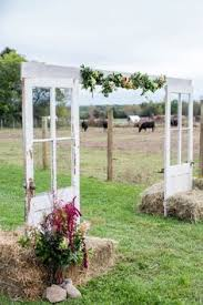 wedding arch using doors backyard wedding ideas white roses barn doors and backdrops