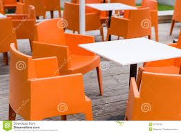 Orange Chair by Modern Furniture Outdoor Cafe Terrace With Orange Chairs Stock
