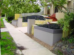 Retaining Wall Garden Bed by Retaining Wall Systems Stores Rain Water Great Designs