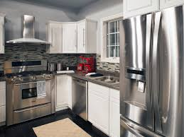 stainless steel appliances dark gray countertops and a gray