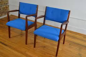 jens risom walnut arm chairs in electric blue maharam kvadrat wool