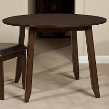 wooden round top drop leaf dining table by intercon wolf and