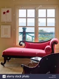english regency pink chaise longue in bedroom with louise
