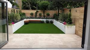 Patio Garden Designs by Artificial Grass And Decking Look Great With Good Garden Lighting