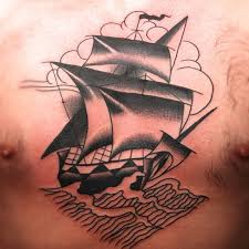 traditional pirate ship and little bird tattoos on chest
