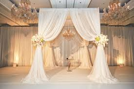 wedding chuppah ceremony décor photos white drapery chuppah chandelier
