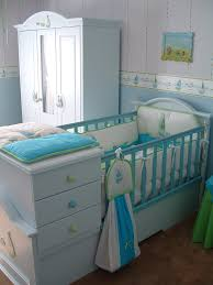 beauty and safe baby room with nautical decoration adorned with