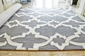 contemporary family room with grey white nedelya trellis rug and