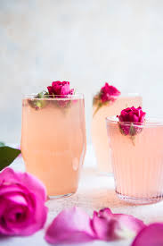party idea freeze rose petals in ice cubes to keep the champagne
