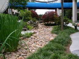 turning your drainage ditch into a beautiful dry stream bed image
