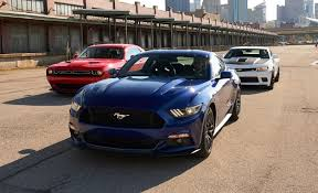 car and driver mustang vs camaro performance data 2015 ford mustang gt vs camaro ss 1le