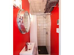 bathroom crown molding gray towels lever faucet pebble tile