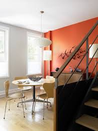 grey and orange for midcentury dining room with orange wall