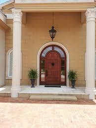Custom Curb Appeal - loving this beautiful wood arch top entryway with wrap around