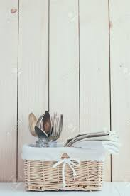 home decor vintage wicker basket and cutlery on a wooden board
