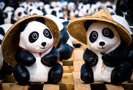 two panda ceramic figurines with bamboo hats free image peakpx