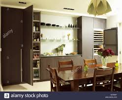 eat in kitchen furniture dining table and chairs in front of central island unit in spacious