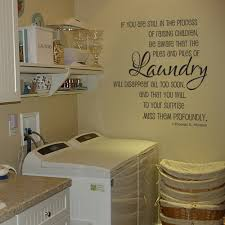 simple laundry room design with double washing machine under white