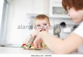 Childrens Kitchen Table by Two Boys Kitchen Table Eating Stock Photos U0026 Two Boys Kitchen