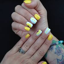 yellow shellac hand drawn sunflower accent nails summer nails