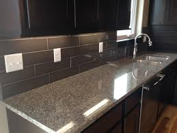 kitchen backsplash in a 4x16 dark subway style tile design by