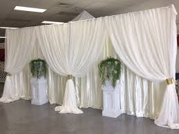 wedding backdrop panels ivory satin backdrop with sheer voile panels in front