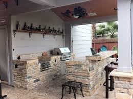 outdoor kitchen backsplash rustic outdoor kitchen spaces with built in grill resistant mosaic