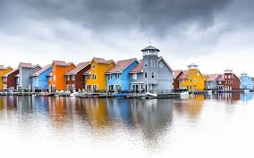 bright colors house at river front hd wallpapers rocks