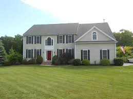 what is a colonial house traditional straight front colonial looks good with offset forward