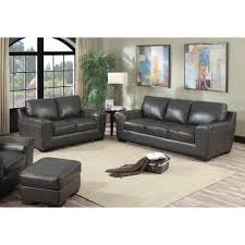 living room beige leather sofa and loveseat on gray reclining