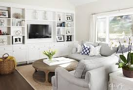 Built In Bookshelves Around Tv by 4 Ways To Disguise A Tv Grey Sectional Open Shelves And Joinery
