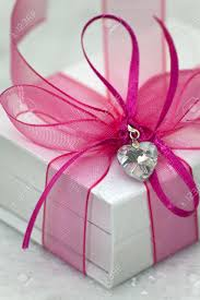 satin ribbon bows a white box with a pink satin ribbon bow a gift for