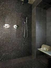cool bathroom tiles design ideas along with compact shower space monochromatic dark bathroom tile design paired with white tub also stainless steel shower head