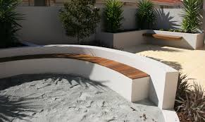 rendered outdoor wall with seating for curved garden wall ideas