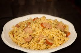 thanksgiving egg noodles sausage brats and beer with mustard over egg noodles