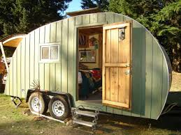 wooden style caravan or prefab home with green wall paint exterior