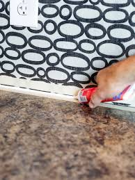 Caulking Kitchen Backsplash Make A Renter Friendly Removable Diy Kitchen Backsplash Hgtv