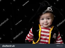 halloween black background image adorable baby boy pirate costume halloween stock photo 61686085