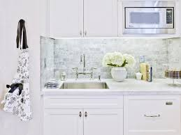 backsplash for white kitchens white kitchen makes extensive use of marble on the countertops and
