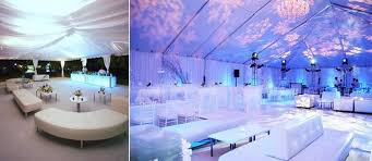 white and black couches and chairs with purple lights bring style