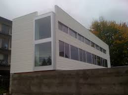 exterior modern white hardiplank siding with glass wall for