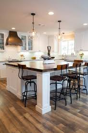 Small Kitchen Island With Seating by Two Pendant Lights Illuminate A New Kitchen Island With A