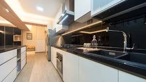 black glass backsplash kitchen kitchen cabinets with black quartz countertop and black tempered