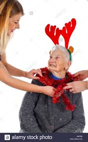 what to get an elderly woman for christmas portrait of an elderly woman wearing christmas decoration on an