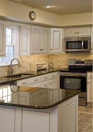 Cream Colored Kitchen Cabinets by Would Love To Have A Kitchen With An Island And Black Marble