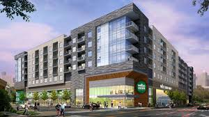 whole foods and morgan group u0027s apartment grocery store project