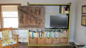 add a pipe rail to a shelving unit for a sliding rustic door to