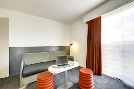 Tv And Lounge Area Picture Of Novotel Roissy Hotel Ibis Styles Charles De Gaulle Roissy Booking Com