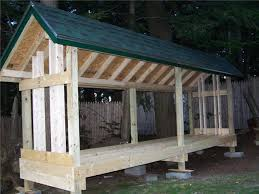 Plans To Build A Small Wood Shed by Firewood Shed Designs Shed Diy Plans
