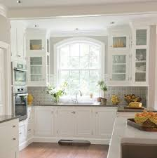 kitchen cabinets in front of windows kitchen traditional with